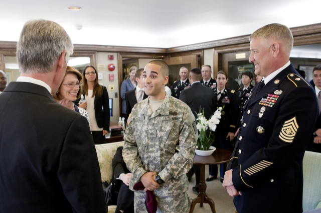 Pfc. Eddie Munoz, 3rd Brigade Combat Team, 47th Calvary Regiment, Fort  Bragg, N.C., speaks with Secretary of the Army John McHugh and Sgt. Maj. of the Army Raymond F.  Chandler III, prior to the Army's 237th Birthday Week kick-off event at George Washington's Mount Vernon estate, Alexandria, Va., June 11, 2012. Munoz, who is recovering from wounds received in Afghanistan, was one of three Soldiers presented the Purple Heart medal during the ceremony June 11, 2012. George Washington established the Purple Heart award during the Revolutionary War.