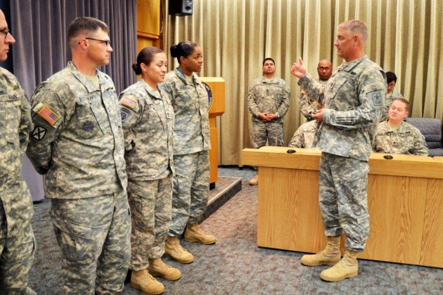 Sgt. Maj. of the Army Raymond Chandler hands out coins to recognize Army Cyber Command Soldiers for their hard work during his visit to Army Cyber Command headquarters at Fort Belvoir, Va., June 7, 2012.
