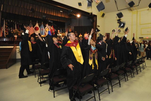 Forty-nine seniors from Zama American High School's class of 2012 toss their caps during their graduation ceremony held June 9 at Camp Zama's Music Theater Workshop. More than 500 family members, friends and community guests attended the ceremony.