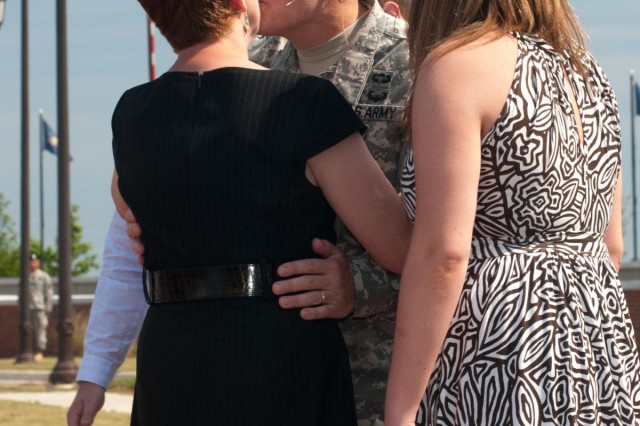 Lt. Gen. Talley receives a kiss from his wife, Linda, during the U.S. Army Reserve Command promotion ceremony and change-of-command ceremony at Fort Bragg, N.C., June 9, 2012. Talley becomes the 32nd Chief, U.S. Army Reserve and the seventh commanding general of the U.S. Army Reserve Command.