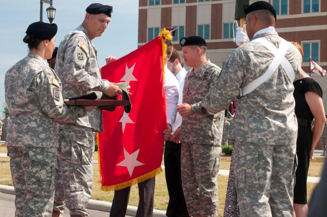 Lt. Gen. Jeffrey W. Talley receives his three-star flag from his son, Christopher, as Chief of Staff of the Army Gen. Raymond T. Odierno presides, during the U.S. Army Reserve Command promotion ceremony and change-of-command ceremony at Fort Bragg, N.C., June 9, 2012. Talley becomes the 32nd Chief, U.S. Army Reserve and the seventh commanding general of the U.S. Army Reserve Command.