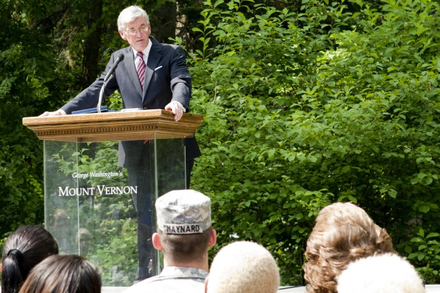 Secretary of the Army John McHugh gives remarks during the Army's 237th  Birthday Week kick-off event at George Washington's Mount Vernon estate,  Alexandria, Va., June 11, 2012.  During the ceremony, McHugh and Sgt. Maj. of the Army Raymond F. Chandler III presented three Soldiers with the Purple Heart medals.  George Washington established the Purple Heart Medal during the Revolutionary War.