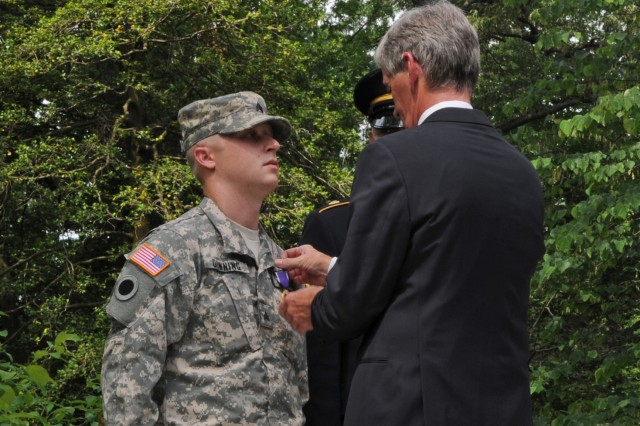 Sgt. Darren Downing receives the Purple Heart medal from Army Secretary John McHugh at Mount Vernon, home of the country's first commander in chief Gen. George Washington. The secretary kicked off the Army's 237th birthday week celebration by laying a wreath at Washington's tomb and pinning Purple Heart medals on three Soldiers, June 11, 2012.
