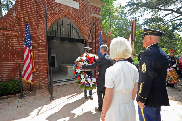 Secretary of the Army John McHugh and a member of the Honor Guard place a wreath in the tomb of Gen. George and Martha Washington at the Mount Vernon estate in northern Virginia, June 11, 2012, during the kickoff of the 237th Army birthday celebration, as Sgt. Maj. of the Army Raymond F. Chandler III and Mount Vernon Ladies' Association Regent Ann Bookout look on.