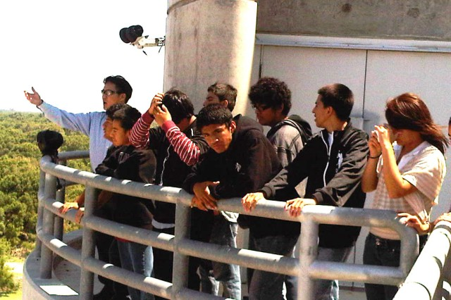 Ninth grade students from Roosevelt High's Math, Science and Technology Magnet Academy stand atop the Prado Dam intake tower overlooking the wildlife basin as Michael Siu, Prado's supervisory engineer,  explains the dam's benefits.
