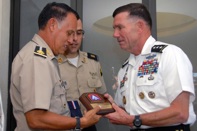 Lt. Gen. William Caldwell IV, commander, U.S. Army North and senior mission commander of Fort Sam Houston and Camp Bullis, Texas, offers a U.S. Army North plaque to one of the senior Mexican generals May 30, 2012, at the executive seminar in Mexico City. Twelve U.S. 3-star generals met with twelve Mexican 3-star generals to discuss issues that affect both armies.