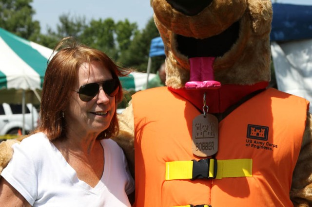 Bobber the Water Safety dog visits with Jo-Ellen Darcy, the Assistant Secretary of the Army for Civil Works, during Get Outdoors Day at Blue Marsh Lake. The U.S. Army Corps of Engineers' Philadelphia District hosted the day to encourage outdoor activity and water safety.