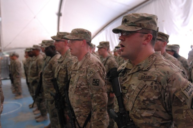 Soldiers of the 411th Engineer Brigade sing the Army Song during a transfer of authority ceremony on Bagram Airfield, Afghanistan, June 4, 2012. The incoming 411th engineers will consolidate military engineer units throughout Afghanistan under Joint Task Force Empire by the end of the year.