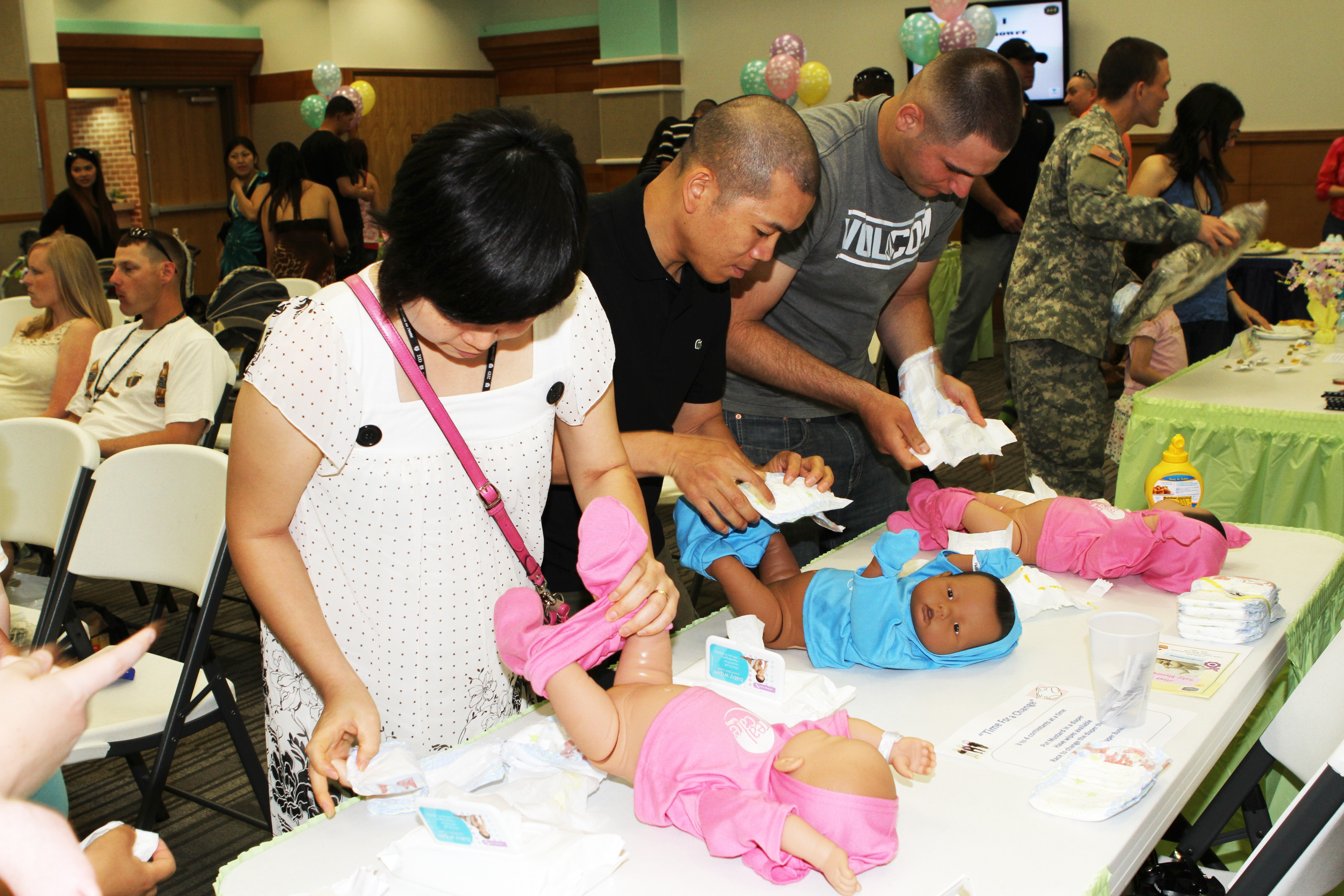 Baby shower introduces dads to diapers Article