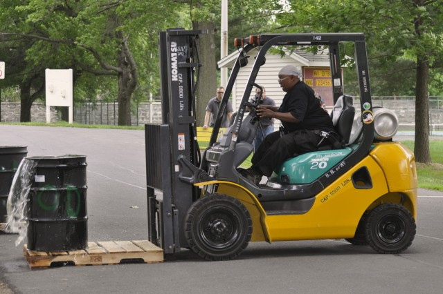 What a way to start a forklift rodeo as Evette Mortimore loses several gallons of water before the first pallet was picked up.  Her team went on to win the competition.