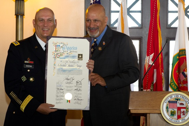 Army Chief of Staff Gen. Raymond T. Odierno receives a plaque from Los Angeles Councilman Dennis Zine at a breakfast with civic leaders in Los Angeles, June 12, 2012.