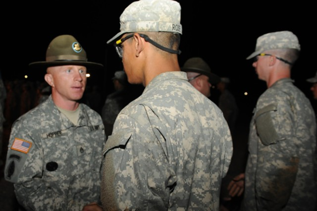 Staff Sgt. David Hopper congratulates the Soldiers of his unit for their completion of Basic Combat Training.