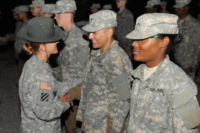 Sgt. 1st Class Tami Bethel, Company B, 795th Military Police Battalion, shakes the hand of every Soldier during the unit's Value Tag Ceremony, congratulating them on a job well done during Basic Combat Training.