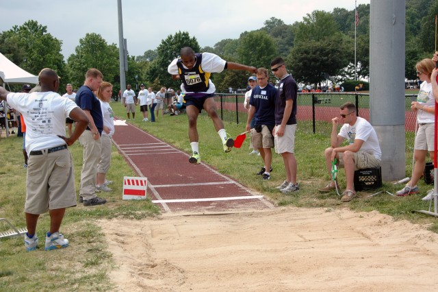 Jerome Carrol of Glenarden, MD performs his best jump of the day, earning him a gold medal in the long jump at the Washington D.C. Special Olympics.