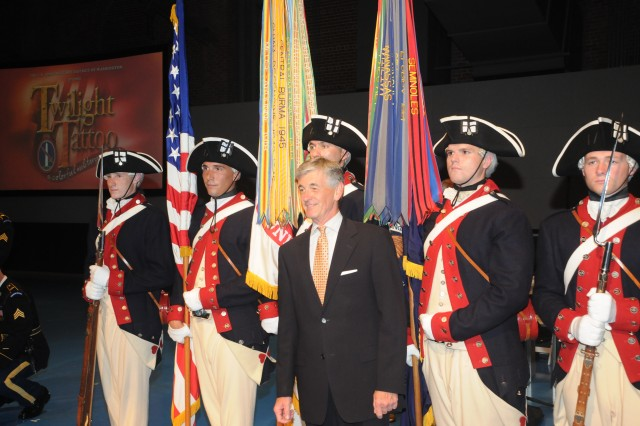Soldiers of the 3d U.S. Infantry Regiment (The Old Guard) stand with Secretary of the Army John M. McHugh after performing the U.S. Army Military District of Washington's Twilight Tattoo at Joint Base Myer-Henderson Hall, Va., June 12, 2012.