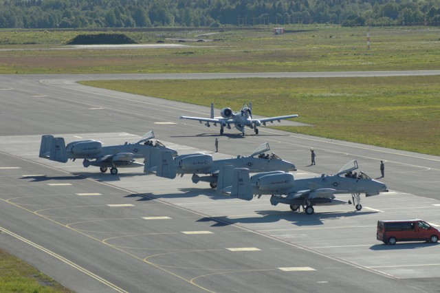 The final U.S. Air Force A-10 Thunderbolt II aircraft of a four-ship formation taxies in at Amari Air Base, Estonia, June 8, 2012. The aircraft, flown by the 107th Fighter Squadron, Michigan Air National Guard, are believed to be the first A-10s to ever land in Estonia. The aircraft and their Airmen were in Estonia to participate in Saber Strike 2012, a multi-national exercise based in Estonia and Latvia. The Joint Multinational Training Command in Grafenwoehr, Germany, provided personnel, training aids and devices to assist forces from Canada, Estonia, France, Latvia, Lithuanian, the United Kingdom and the United States, as they engaged the enemy and overcome challenges in interoperability during the two-week exercise.
