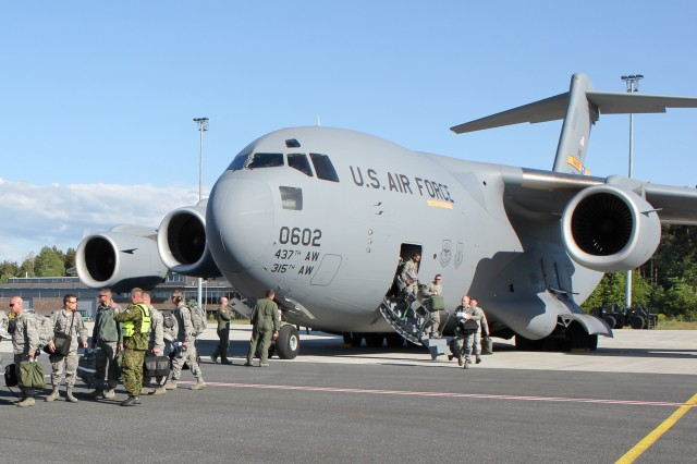 Airmen from the 127th Wing, Michigan Air National Guard, disembark from a C-17 Globemaster at Amari Air Base, Estonia, June 8, 2012. The C-17 was delivering cargo and Air Force personnel to Estonia to participate in Saber Strike 2012, a multi-national exercise based in Estonia and Latvia. The Joint Multinational Training Command in Grafenwoehr, Germany, provided personnel, training aids and devices to assist forces from Canada, Estonia, France, Latvia, Lithuanian, the United Kingdom and the United States, as they engaged the enemy and overcome challenges in interoperability during the two-week exercise.