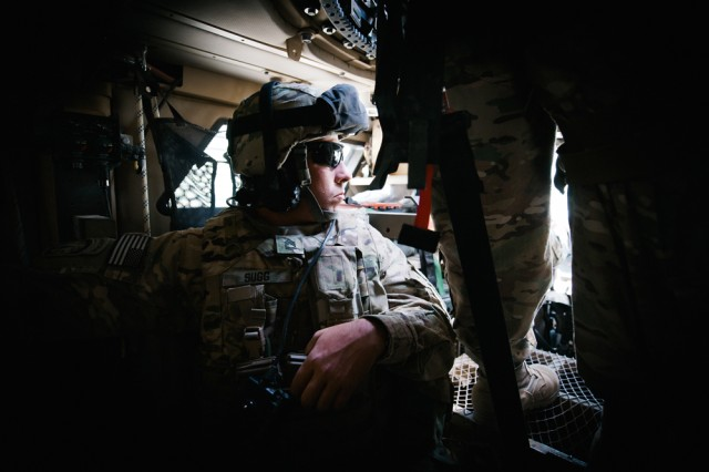 A Fort Riley, Kan., Soldier serving in Afghanistan with the 1st Infantry Division's headquarters battalion looks out the front window of an armoured vehicle during a convoy from Bagram Airfield to a forward operating base in Parwan Province, June 11.