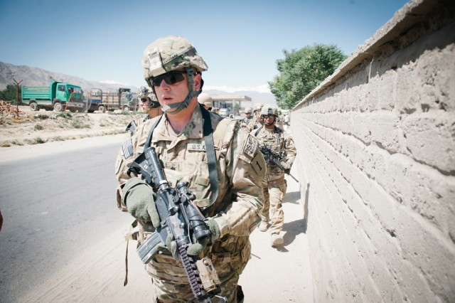Lt. Col. James Davis, commander of the 1st Infantry Division's headquarters battalion and Task Force Defender, leads a platoon of Soldiers down a highway in eastern Afghanistan's Parwan Province, June 11.