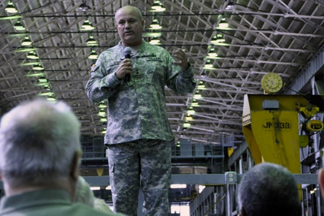 Maj. Gen. Kurt J. Stein talking to more than 300 of the Arsenal's workforce during a September 2011 town hall meeting.