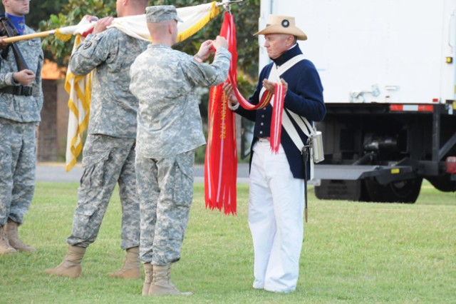 The 98th Army Band and a local reenactment group perform an Army Streamer Ceremony during a Music Under the Alabama Stars concert last year. The next MUTAS concert, June 22 at 6:30 p.m. at Howze Field, will celebrate the Army's birthday and again feature a Streamer Ceremony that describes the history of the service.