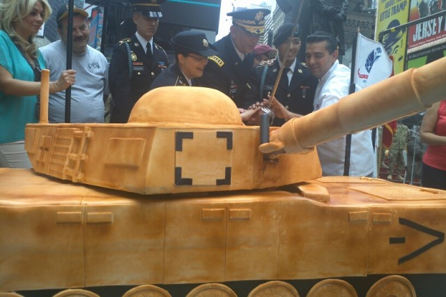 """Gen. Raymond Odierno, Army Chief of Staff, cuts the Army Birthday cake in celebration of the Army's 237th birthday with youngest Soldier Pvt. Chayanne Jose Pena, 69th New York National Guard, and Buddy Valastro, the founder of the Cake Boss television show at Duffy Square, New York City, June 14. """"Our freedoms and liberties are unique here and our Army protects those liberties, we are here for the American people,"""" said Odierno.  (Cutline provided by Staff Sgt. Matthew Coffee)"""