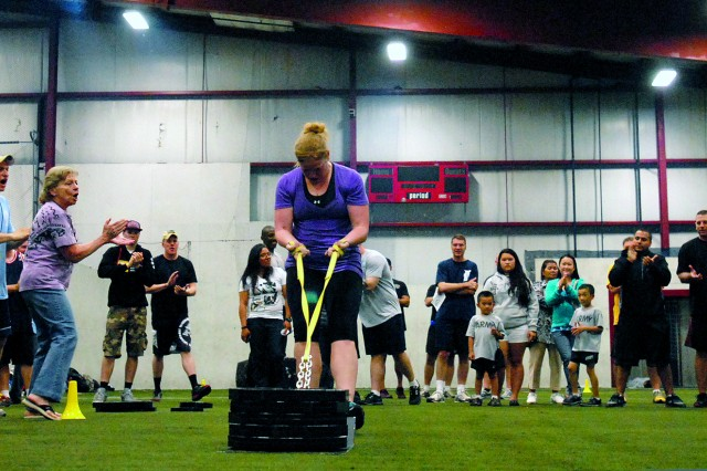 Cortney Lyons, the only female participant during the competition, pulls a 225-pound weight sled across the finish line during the Strongest Warrior competition Saturday in Watertown. Hosted by the Fort Drum Chapter, National Association of the 10th Mountain Division, the event was open to all civilians and military service members.