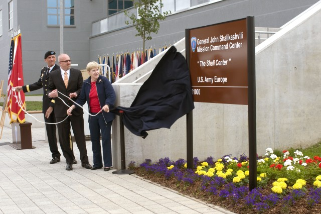 Lt. Gen Mark Hertling, commander of U.S. Army Europe (left); Joan Shalikashvili, wife of late Gen. John Shalikashvili, and her son, Brant, unveil the sign in front dedicating the 'Shali Center' -- the Gen. John Shalikashvili Mission Command Center on Clay Kaserne (formerly Wiesbaden Army Airfield), in Wiesbaden, Germany, June 14, 2012. The MCC is designed to support the USAREUR, headquarters, now in the process of moving to Wiesbaden from Heidelberg, in its mission of training and preparing U.S. and allied and partner nation forces with full-spectrum capabilities.