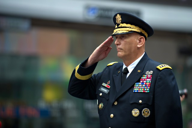 Army Chief of Staff Gen. Raymond T. Odierno salutes during the playing of the National Anthem in a ceremony celebrating the U.S. Army's 237th birthday, June 14, 2012, at Times Square in New York City.