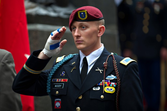 First Lt. Alexander Woody, from the 82nd Airborne Division, salutes during the playing of the National Anthem in a ceremony celebrating the U.S. Army's 237th birthday, June 14, 2012, at Times Square in New York City. Woody was wounded in combat in Afghanistan.