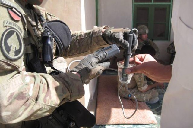 Soldiers from 1/64 AR, 2BCT, 3rd ID, work with the local population in Afghanistan while conducting well water calculations. The Soldiers have been able to make an impact on the community through the Commander Emergency Relief fund.