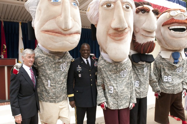 "Secretary of the Army John McHugh and Vice Chief of Staff of the Army Gen. Lloyd J. Austin III, pose with the ""Running Presidents,"" mascots for Major League Baseball's Washington Nationals, during the Army's 237th birthday celebration held in the Pentagon Center Courtyard June 14, 2012. (Army Photo by Spc. John G. Martinez)"