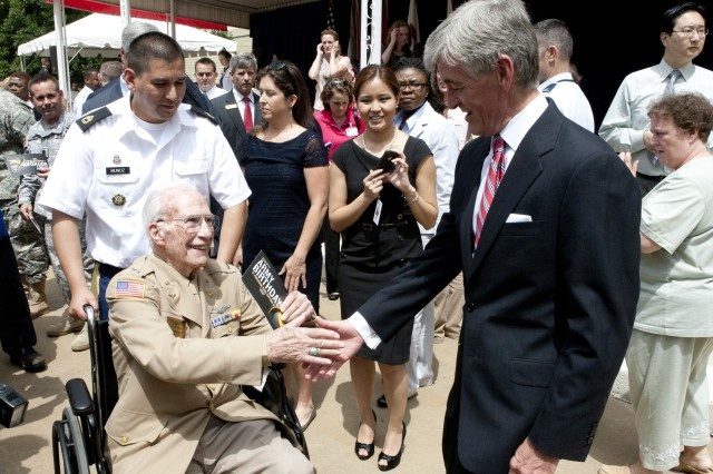 Secretary of the Army John McHugh greets Herb Heilbrun, a World War II B-17 pilot, following the Army's celebration of its 237th birthday in the Pentagon Center Courtyard June 14, 2012. (Army Photo by Spc. John G. Martinez)