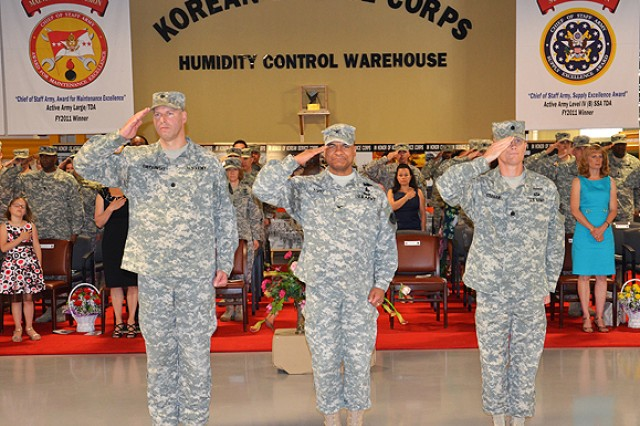 (From left)  Lt. Col. Douglas P. Pietrowski, outgoing commander, Army Field Support Battalion - Northeast Asia, Col. Michael C. Lopez, commander, 403rd Army Field Support Brigade, and Lt. Col. Gary J. Cregan, incoming commander. AFSBn-NEA, and attendees salute the national flag while the Republic of Korea Army band plays the national anthems of Korea and the United States during the AFSBn-NEA change of command ceremony at Camp Carroll, Korea, May 25.