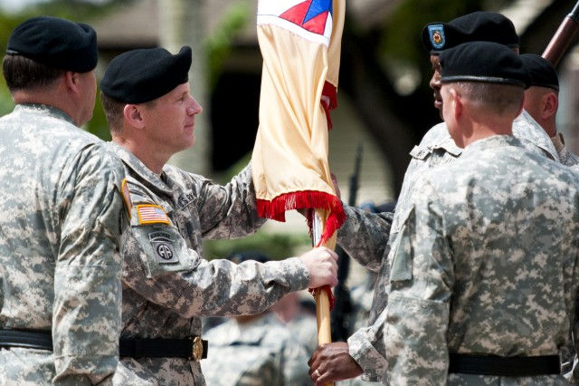 Maj. Gen. Stephen Lyons, incoming command of the 8th Theater Sustainment Command, hands the command colors back to Command Sgt. Maj. Nathan Hunt during his change of command ceremony at Hamilton Field on Schofield Barracks, June 13.