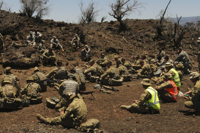 "POHAKULOA TRAINING AREA, Hawaii "" Soldiers from the 1st Battalion, 14th Infantry regiment and the 7th Royal Australian Regiment conduct and after action review following a blank run of their live fire exercise on June 6 here. The exercise is part of the Theatre Security Cooperation Program designed to ensure security in the Pacific region by utilizing allied forces in combined operations."