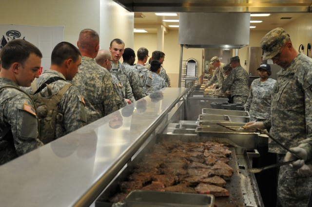 Where's the beef? Command sergeants major from the 91st Division, Regional Training Center-West and Fort Hunter Liggett garrison serve up t-bone steaks to Soldiers at the dining facility's Army Birthday festivities.