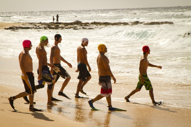 The six competitors of the first heat for the male 25-34 year old division stroll towards the crashing waves during the 2012 Sandy Beach Kaha Nalu Championships, June 2 at Sandy Beach Park, Honolulu, Hawaii.