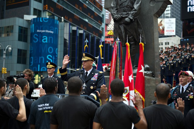 Army Chief of Staff Gen. Raymond T. Odierno administers the oath of enlistment to future Army Soldiers during a ceremony at Times Square in New York City, June 14, 2012, in celebrating the U.S. Army's 237th year birthday.