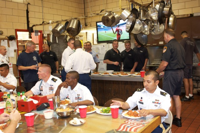 """Soldiers from 3rd Squadron, 71st Cavalry Regiment, 3rd Brigade Combat Team, 10th Mountain Division, visited firefighters from Engine 326, Ladder 160, Battalion 53 """"Road Warriors"""" located in Queens, N.Y., June 12 as part of a community outreach campaign tied in with the Army's 237th birthday."""