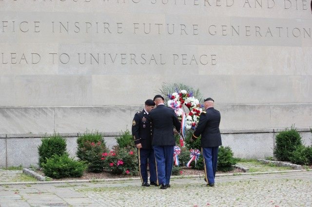 Soldiers from Fort Drum and 10th Mountain Division conduct a wreath laying ceremony during the Brooklyn War memorial re-dedication ceremony June 12 in the Cadman Plaza in Brooklyn, N.Y. The Soldiers participated in various community outreach events through New York City during the week.