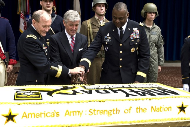 Gen. Martin E. Dempsey, chairman of the Joint Chiefs of Staff, joins Army Secretary John M. McHugh and Army Vice Chief of Staff Gen. Lloyd J. Austin III in celebrating the Army's 237th birthday during a cake cutting ceremony in the courtyard of the Pentagon, June 14, 2012.