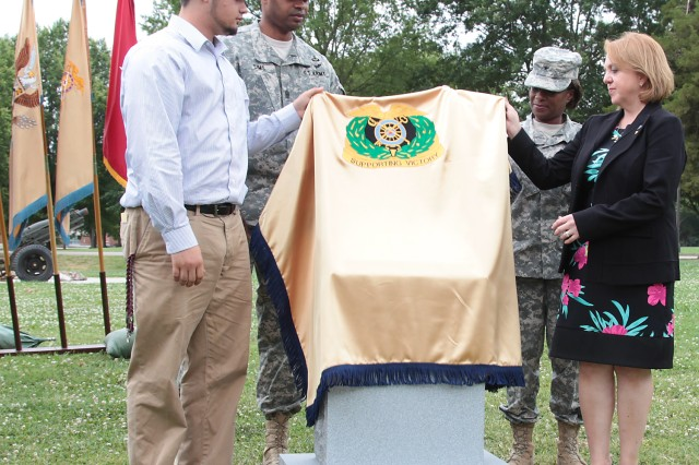 With the assistance of Command Sgt. Maj. James K. Sims, Quartermaster Corps' top noncommissioned officer, and Brig. Gen. Gwen Bingham, QM General and QM School commandant, Jonathan Hildner and Cindy Hildner unveil a marker honoring the memory of Brig. Gen. Terence J. Hildner, former commanding general of the 13th Sustainment Command (Expeditionary), Fort Hood, Texas, during a ceremony at Fort Lee, Va., Thursday. Hildner, Jonathan's father and Cindy's husband, died Feb. 3 in Kabul, Afghanistan, of natural causes. The marker, along with a dogwood tree planted in Hildner's memory, is located near the 1st Logistics Command War Memorial. From July 2007 to 2010, Hildner served at Fort Lee, where he commanded the 23rd QM Brigade, QM School, and then served as the Combined Arms Support Command G3/director, Training and Doctrine.