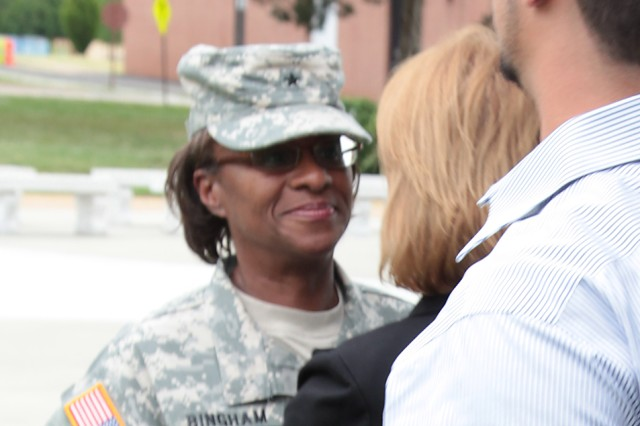 Brig. Gen. Gwen Bingham, Quartermaster General and QM School commandant, shares an embrace with Cindy Hildner, widow of Brig. Gen. Terence J. Hildner, former commanding general of the 13th Sustainment Command (Expeditionary), Fort Hood, Texas, following a ceremony honoring Hildner Thursday at Fort Lee, Va. During the ceremony, a marker was unveiled near a dogwood tree that was planted in memory of the former 23rd QM Brigade commander.