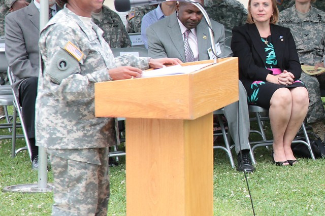 With his widow listening on, Brig. Gen. Gwen Bingham, Quartermaster General and QM School commandant, talks about Brig. Gen. Terence J. Hildner, former commanding general of the 13th Sustainment Command (Expeditionary), Fort Hood, Texas, and his selfless service during a ceremony Thursday at Fort Lee, Va. Hildner, a former commander of the 23rd QM Brigade, died Feb. 3 in Kabul, Afghanistan, of natural causes. Also during the ceremony, a marker was unveiled near the dogwood tree planted in memory of Hildner.