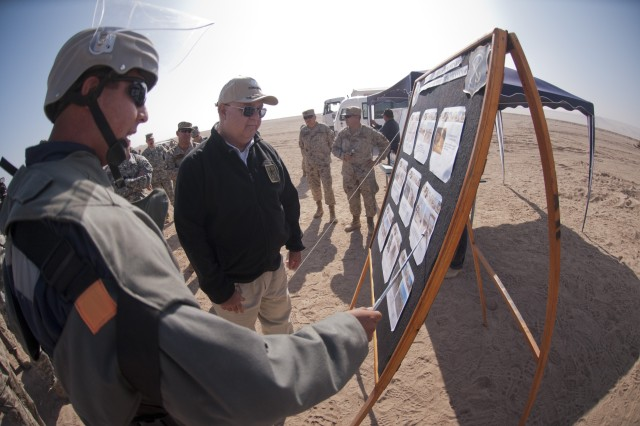 A Chilean bomb disposal expert describes to Under Secretary of the Army Joseph W. Westphal how dangerous munitions are safely removed from the Chilean and Peruvian border during humanitarian demining operations during a recent visit to Quebrada de Escritos, Chile, June 11, 2012.  Westphal participated in the 12th U.S. and Chile Defense Consultative Commission and visited with select Chilean Army units to expand partnership capacity.  The U.S. and Chilean defense partnership is focused on a range of initiatives, from disaster response to conducting joint exercises and training.