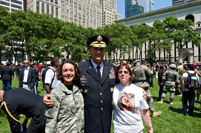 U.S. Army Staff Sgt. Marta Krabill from the Army Blues Band poses for a photo with Army Chief of Staff Gen. Raymond T. Odierno at Bryant Park in New York City during a patriotic celebration in honor of the U.S. Army's 237th birthday, June 14, 2012. in New York, New York.