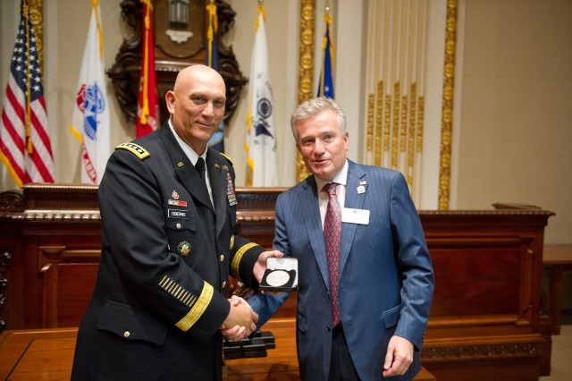 U.S. Army Chief of Staff Gen. Raymond T. Odierno receives a coin commemorating the U.S. Army's 237th year birthday by Duncan Niederauer, chief executive officer and a director of New York Stock Exchange Euronext,  June 14, 2012,in New York City.