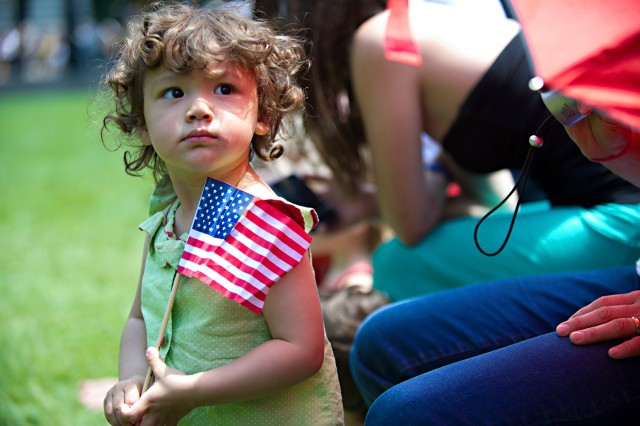 A little girl of a U.S. flag at Bryant Park in New York City during a patriotic celebration at in honor of the U.S. Army's 237th birthday, June 14, 2012.