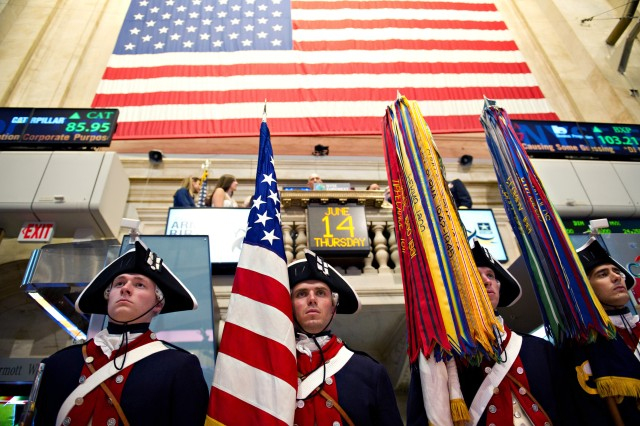 Soldiers from the 3rd infantry Regiment (The Old Guard) carry the colors during a closing bell ceremony at the New York Stock Exchange in celebration of the U.S. Army's 237th birthday, June 14, 2012, in New York City.